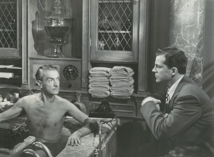 Lydecker is interrogated in a bathtub in Laura