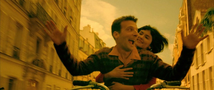 Amelie and Remy ride through the streets of Paris