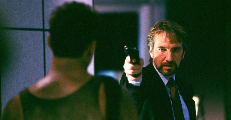Hans Gruber points a gun at John McClane in Die Hard