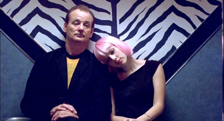 Charlotte leans her head on Bob's shoulder in Lost in Translation