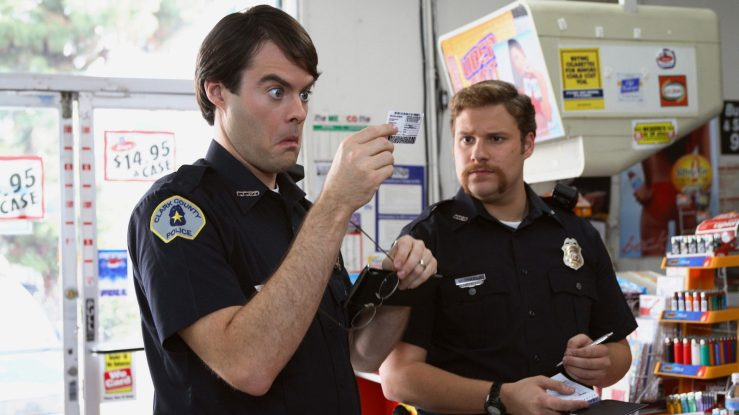 Two officers examine Fogell's fake ID