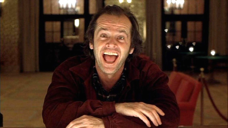 Jack Torrence smiling maniacally in The Shining