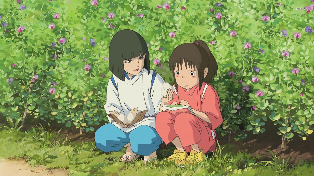Haku comforts Chihiro in Spirited Away