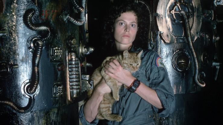 Ripley holds a cat in Alien