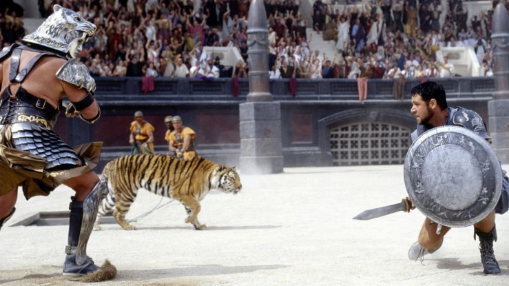Maximus battles a giant man and a tiger in Gladiator