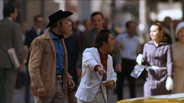 Joe and Ratso yell at a cab driver in Midnight Cowboy