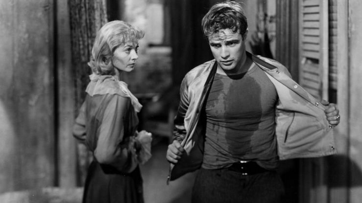 Blanche watches as Stanley takes off his shirt in A Streetcar Named Desire