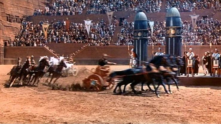 Chariots race as a large crowd watches in Ben-Hur