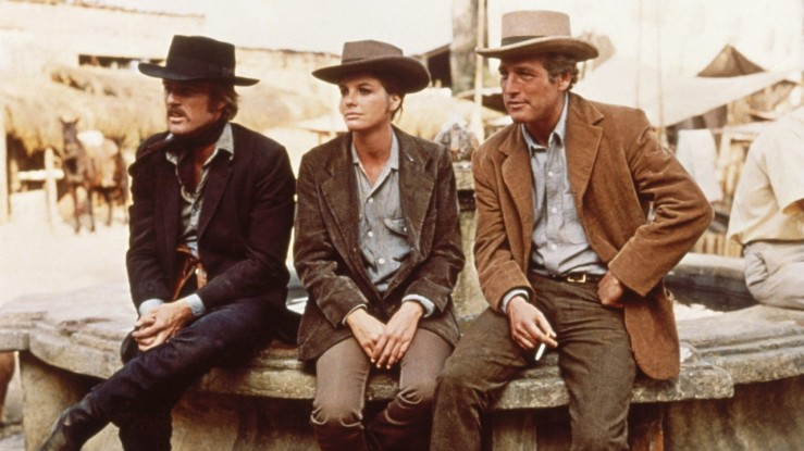 Butch, Sundance, and Etta relax in their cowboy gear in Butch Cassidy and the Sundance Kid