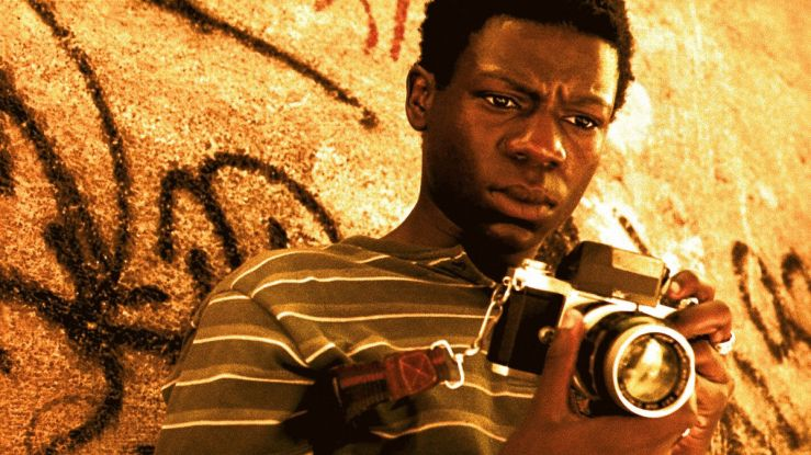 Rocket looks at his camera in City of God