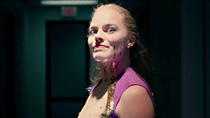 Tonya grinning maniacally with blood on her face in I, Tonya