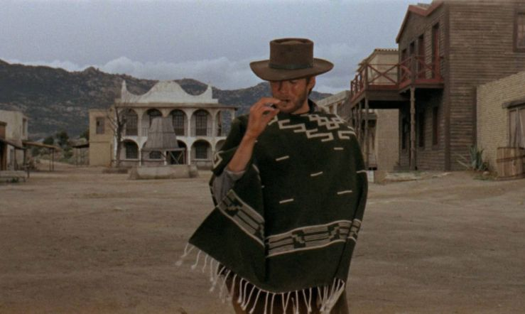 The Man with No Name smokes a cigar in A Fistful of Dollars