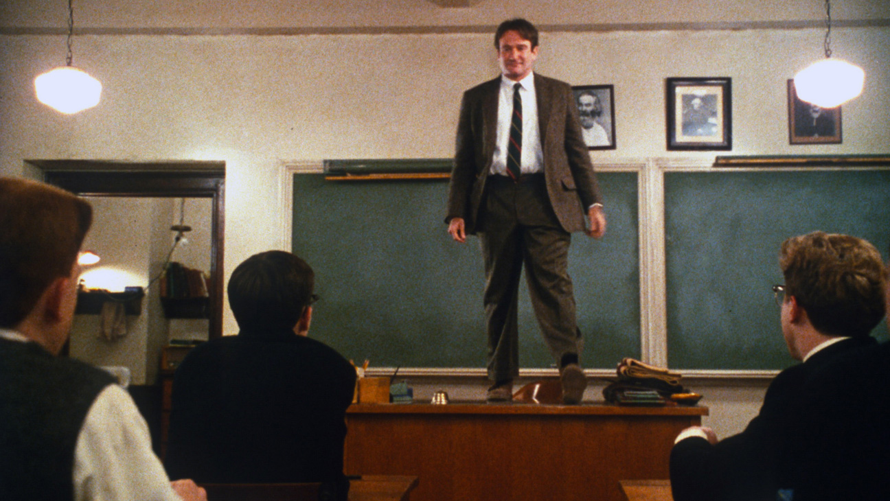 John Keating stands on his desk in Dead Poets Society