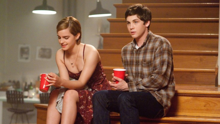 Sam and Charlie share a moment on a staircase in The Perks of Being a Wallflower
