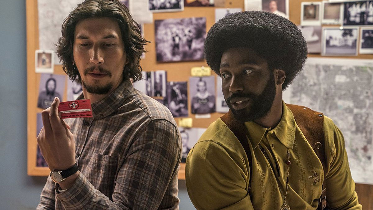 Flip Zimmerman and Ron Stallworth examine a KKK membership care in BlacKkKlansman
