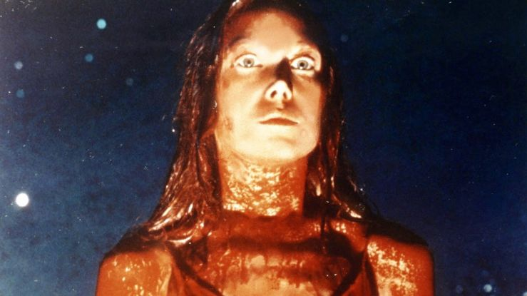 Carrie White stares in horror, covered with blood, in Carrie (1976)