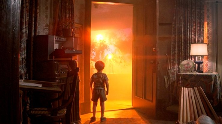 A young child walks out of his house toward a flying saucer in Close Encounters of the Third Kind