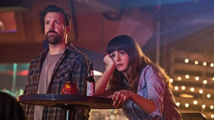 Gloria and Oscar watch the news in Colossal