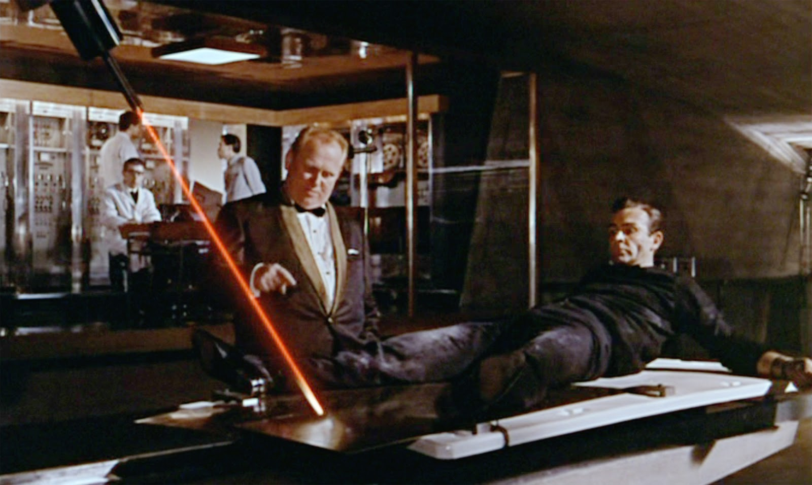 Goldfinger aims his laser at James Bond in Goldfinger