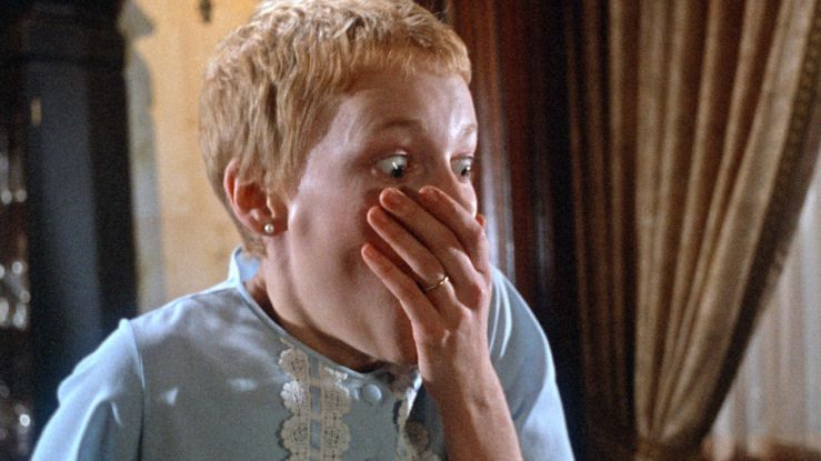Rosemary looks shocked and covers her mouth in Rosemary's Baby