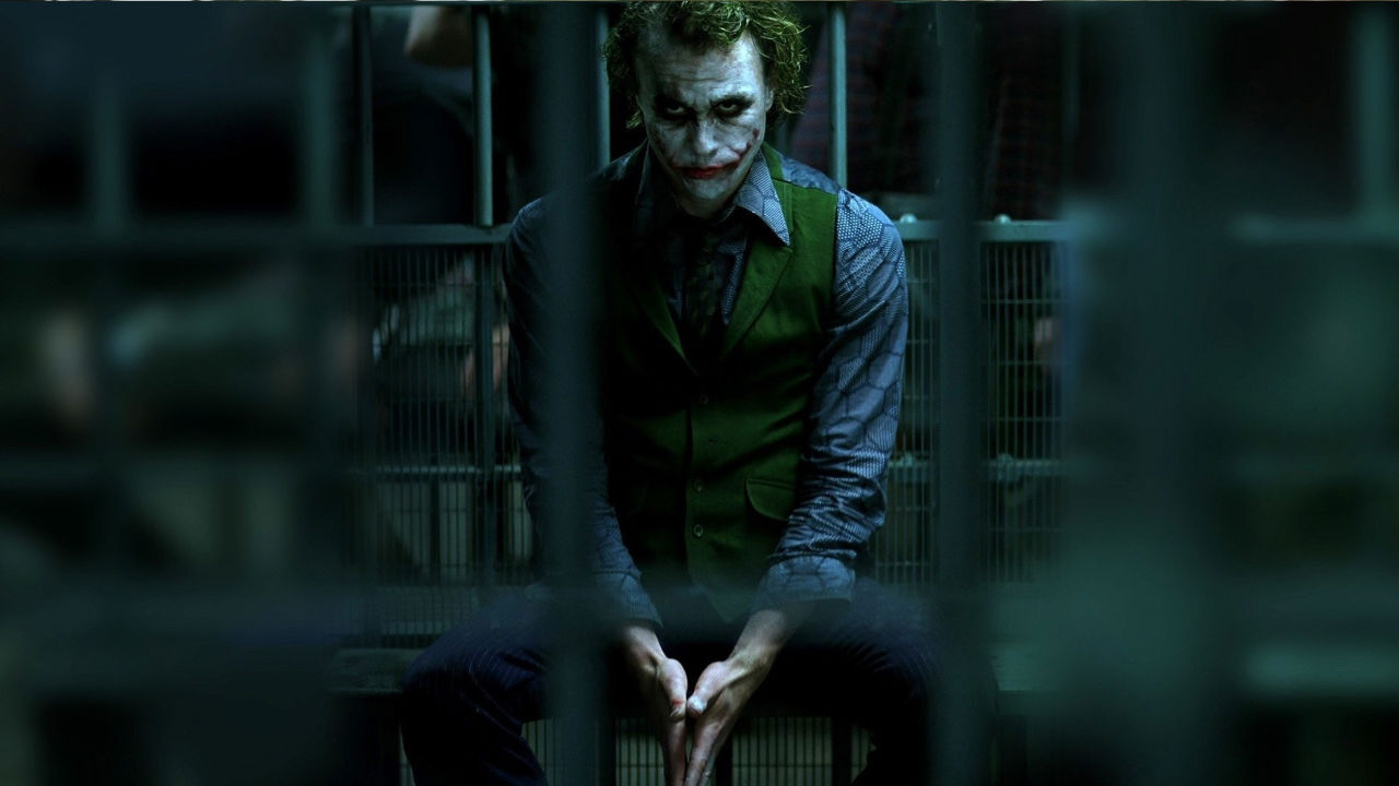 The Joker looks brooding in The Dark Knight