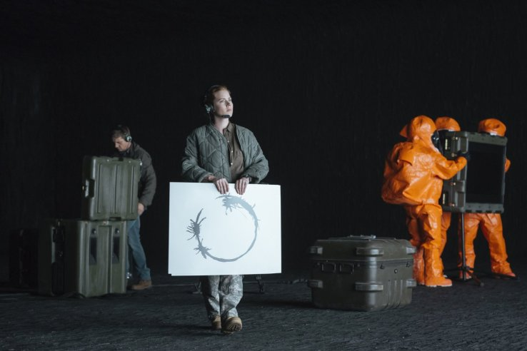 Louise holds a graphic with an alien language in Arrival