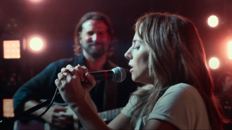 Ally sings as Jackson plays guitar in A Star is Born