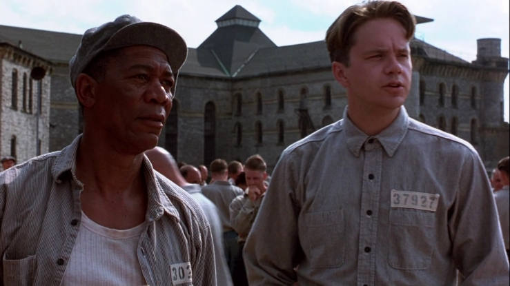 Red and Andy in prison uniforms in The Shawshank Redemption