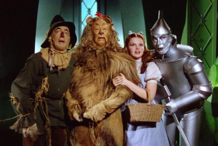 The four principle characters stand in awe of the great and powerful Oz in The Wizard of Oz