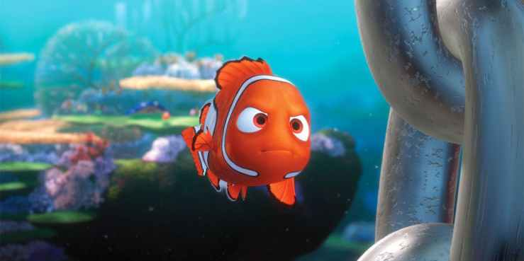 Nemo swims toward a boat with a determined look on his face in Finding Nemo