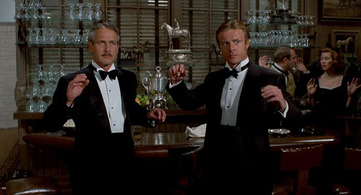 Johnny Hooker and Henry Gondorff put their hands up in The Sting