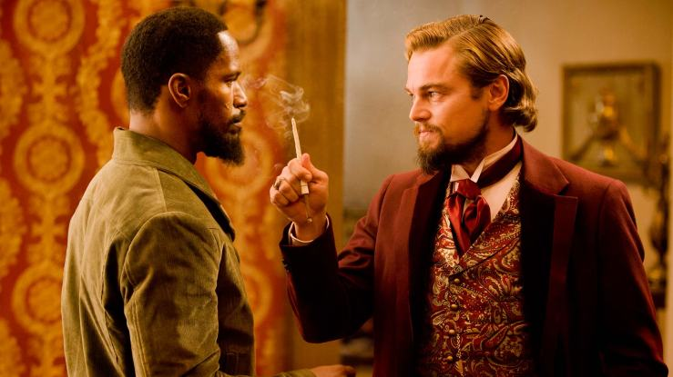 Calvin Candie wags a cigar in Django's face in Django Unchained