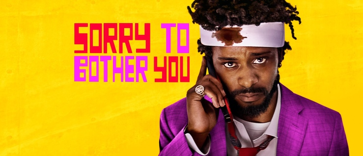 Cassius Greene holds a cell phone to his ear and has a bloody bandage on his head in Sorry to Bother You