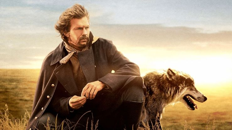 John Dunbar sits in a field with Two Socks the wolf in a promotional photo for Dances with Wolves