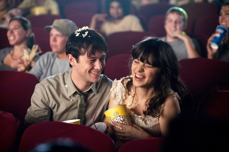 Tom and Summer laugh together in a cinema in 500 Days of Summer