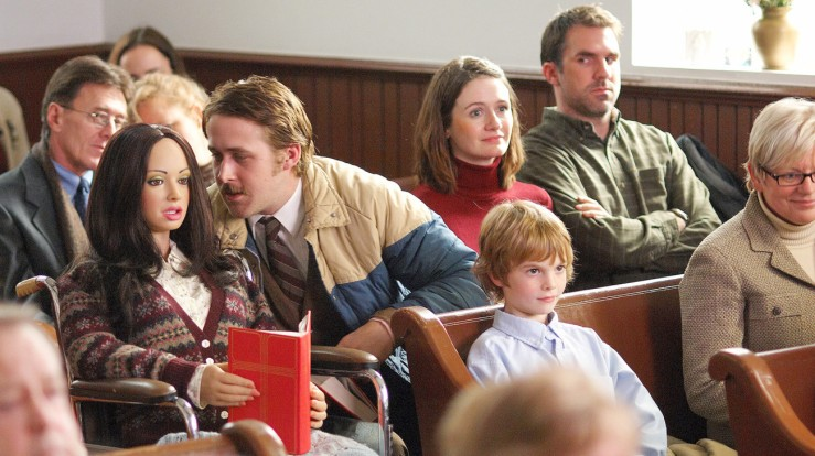 Lars and real girl Bianca sit through a church service in Lars and the Real Girl