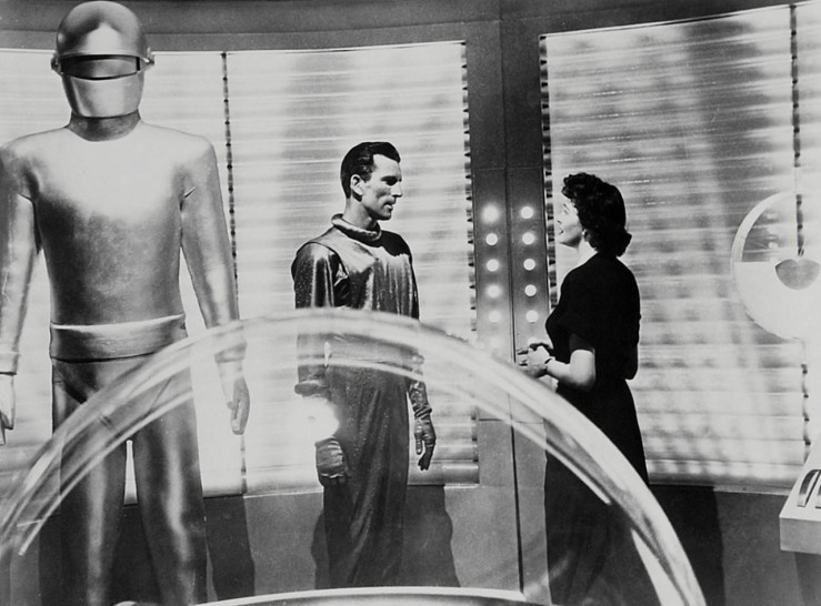 Gort the robot stands tall above Klaatu and Helen in The Day the Earth Stood Still