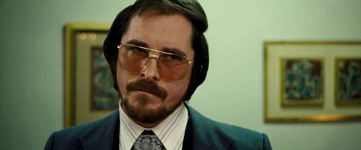 Christian Bale looking suave and sleazy in American Hustle