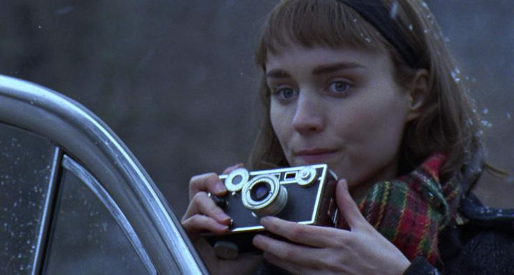 Therese holds a camera in Carol (2015)